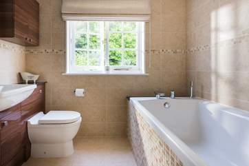 The family bathroom has an extra wide bath.