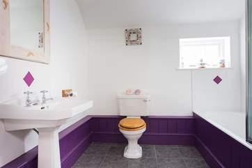 This bathroom is set between Bedroom 2 and Bedroom 3.