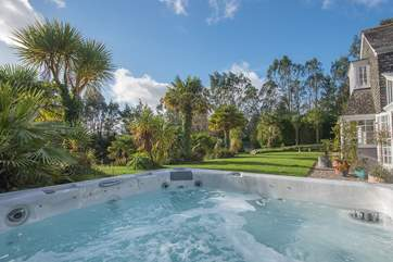 Gaze out over the garden and pond from the hot tub.