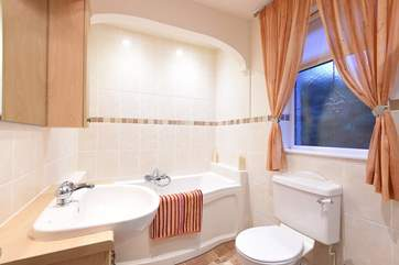 The ensuite  bathroom has a bath and a separate shower cubicle.