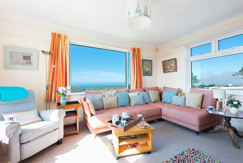 The sitting room with its gorgeous views across open countryside to the sea.
