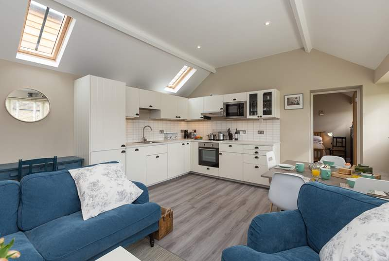 The cottage has bright and welcome open plan living space with the ensuite bedrooms at opposite ends of the cottage.