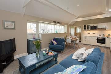 There is a spacious open plan living area, with the two bedrooms - one is en-suite and one has a separate bathroom next to it -  at opposite ends of the cottage.