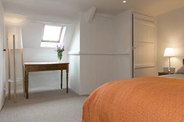 The room has plenty of space and is beautifully presented so that it feels calm and peaceful.