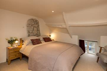This is the lovely double bedroom on the first floor. The sloping ceilings and low cottage window add to the atmosphere.