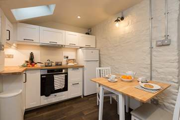 The kitchen/dining room is beautifull designed with lots of very clever bespoke design features to add a contemporary twist to the old cottage.