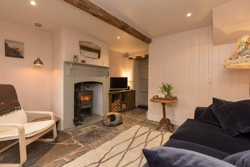 This cosy cottage has a wonderful wood burning stove in the living room and original flagstone floors