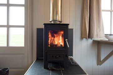 The crackling wood-burner will keep you cosy.