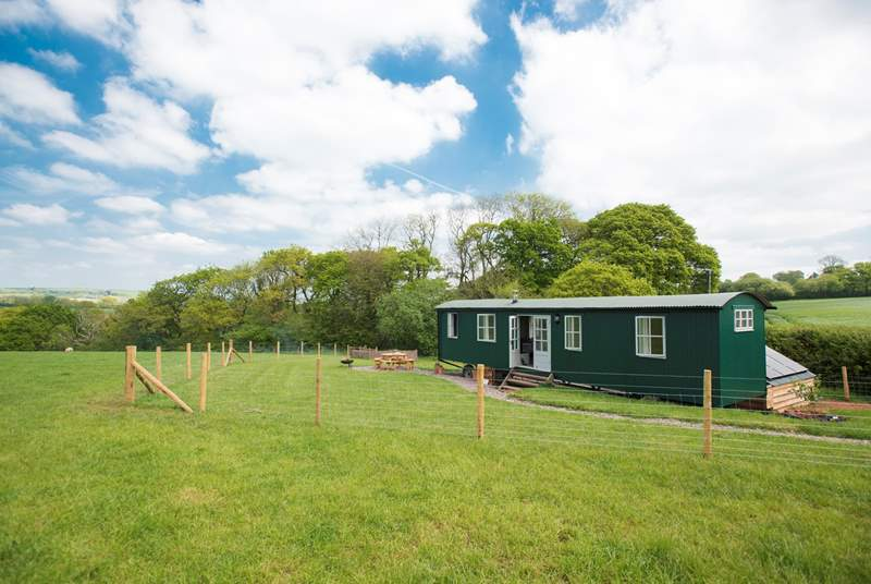The shepherd's hut is in a safely enclosed area with the most wonderful views across open fields and miles away!