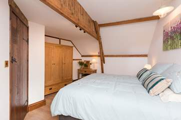 Another view of this bedroom which has kept the lovely character of the original barn, with exposed beams - mind your head on the one closest to the bed!