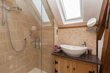 This is the en suite for the second double bedroom.  A low beam adds character but do mind your head.