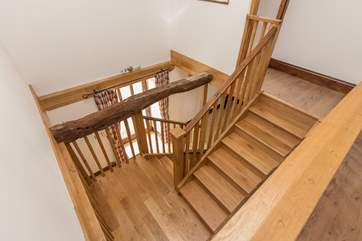 The bespoke wooden staircase is a wonderful design feature in its own right.