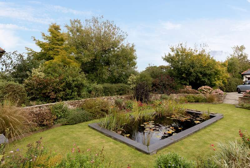 To the front of the cottage there is a beautiful sunken garden with a deep pond. This is a communal area which guests at Dreamcatcher can also enjoy but you do have your privacy in your own back yard.