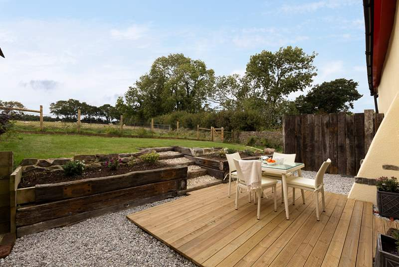 There is a very completely private rear garden with a decking-area as well as a lovely lawn, looking out over the fields.