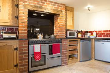 The kitchen has a large range cooker at its heart.