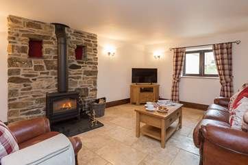 The living area has a wood-burning stove for those autumn and winter evenings, or simply for extra snug atmosphere after a day out walking.