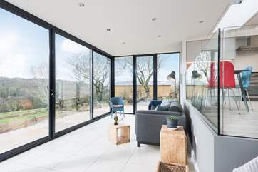 The split-level design ensures the sitting-area has wonderful views over the meadow and countryside beyond.