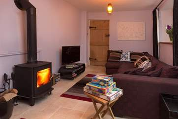 This is the second sitting-room where the television is. There is a lovely stack of DVDs for you to enjoy if you have a wet day.