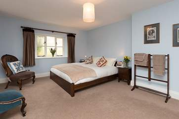 This is the first floor master bedroom (2), also with a king-size bed and wonderful views across the gardens.