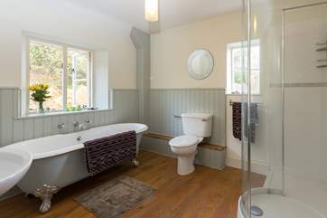 This is one of the wonderful family bathrooms. This one has a roll-top bath and a separate shower cubicle, with lovely polished wooden floor.