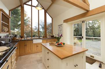 The island, the double Aga, the sink with a view... what a kitchen! Two sets of French windows lead to the terrace as well.