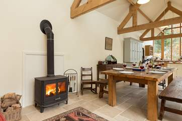 The kitchen/dining-room even has a wood-burning stove and sofa, just out of view, so that you can all enjoy this most sociable of rooms.