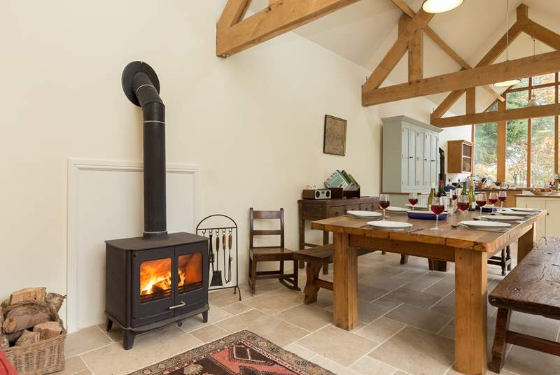 The kitchen/dining room even has a wood burning stove and sofa, just out of view, so that you can all enjoy this most sociable of rooms.