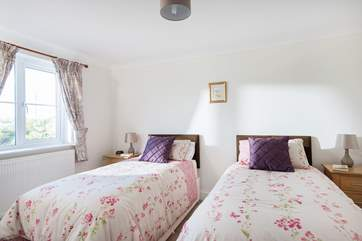 Two 3ft single beds and a view over the village to the front of the cottage.(Bedroom 2)