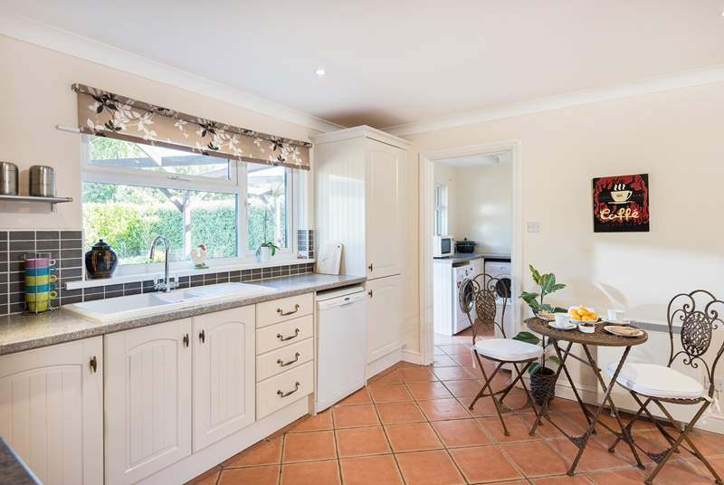 The kitchen leads through to the utility and back door to the garden.