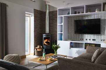 In the warmer months you won't need the wood-burner for heat but it gives you a warm and cosy glow.