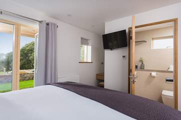 This ground floor bedroom also has an en suite shower-room.
