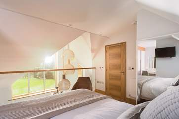 This top floor bedroom is wonderfully light and also enjoys the views down the golf course.