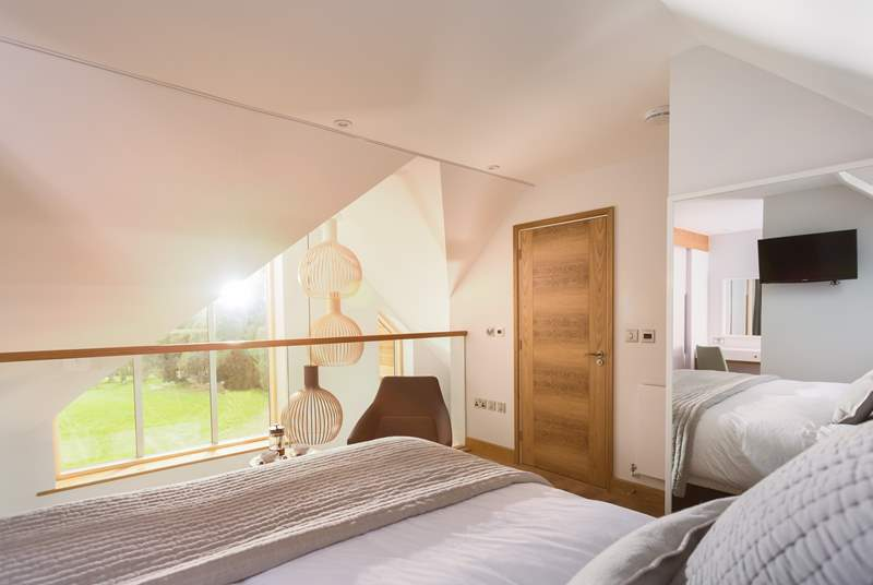 This top floor bedroom is wonderfully light and also enjoys the views down the golf course (Bedroom 3).