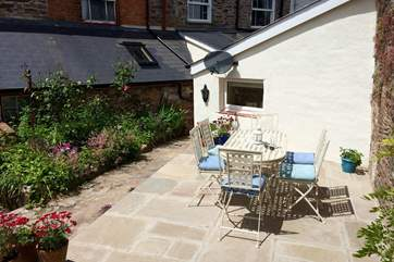 This is the sunny courtyard garden.  No 5 is the stone faced cottage beyond the white fronted sloping part of the building - that is the  ground floor bedroom.