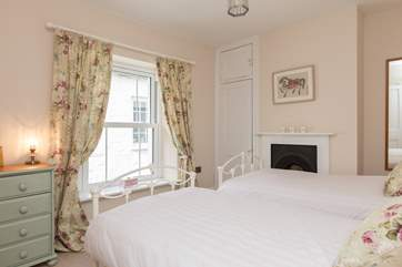 This bedroom even has the original Victorian fireplace as a pretty feature.