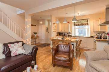 There is a welcoming open plan  kitchen, dining and living area for this cottage.