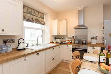 There is a lovely kitchen and a farmhouse kitchen table