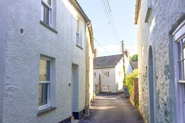 Number 5 is the  period property to the left of this image. It has a wonderfully tucked away courtyard garden at the back.