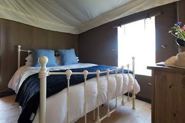 The comfortable king-size bed in Bedroom 1.