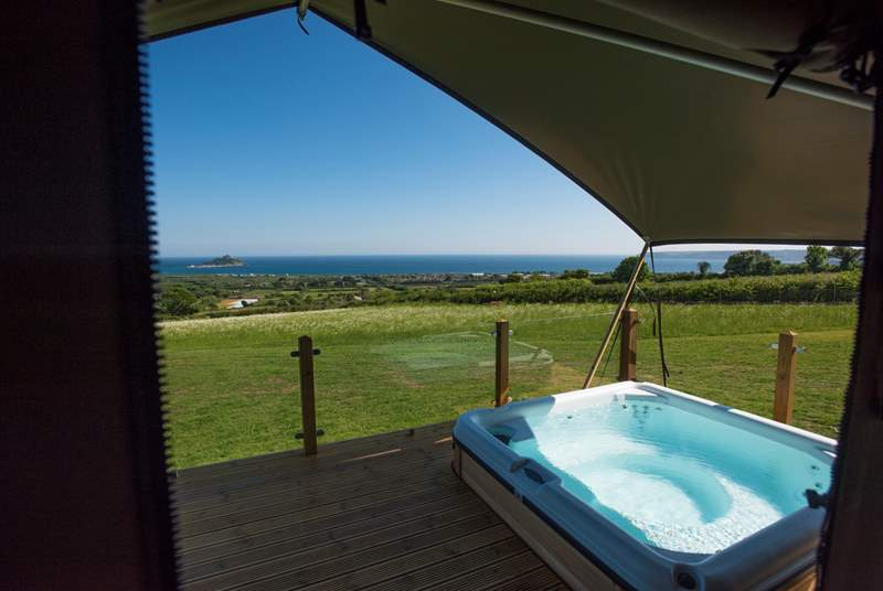 And it even has its very own hot tub also enjoying the views too.