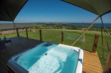 The hot tub sits low in the raised deck with a glazed balcony all around so that you can enjoy the view at all times.