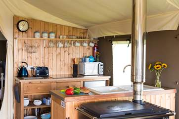 The kitchen-area is fully equipped and includes a  four ring hob, fridge/freezer, microwave, toaster and kettle! There is also the log-fired range to cook on too.