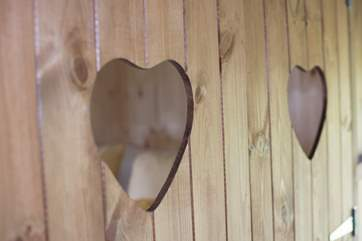 The cute little heart shapes in the cabin bed doors.