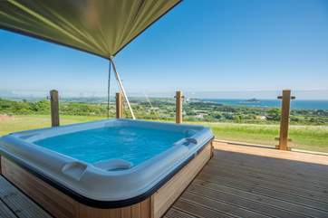 And to top it off, you even have your own hot tub on the deck enjoying the panoramic views too.