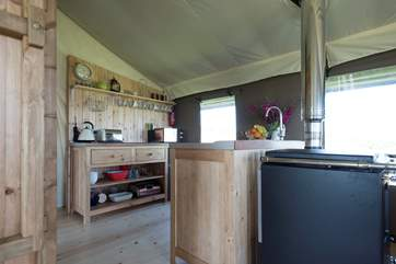 The kitchen area is fully equipped including a fridge/freezer, four ring hob, microwave, toaster and kettle! The log-fired range can also be used for cooking too.