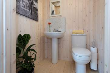 And, at the back of the tent is your en suite cloakroom with proper flushing toilet and wash-basin.