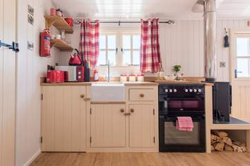 The fully-fitted kitchen with full-size oven and fridge.