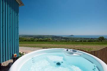 The hot tub is private and sheltered and has the same stunning views.