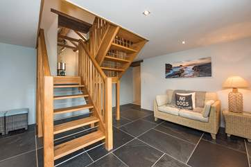 The open plan staircase leads off from the dining-area.
