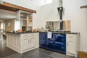 The kitchen has an impressive four-oven Aga.